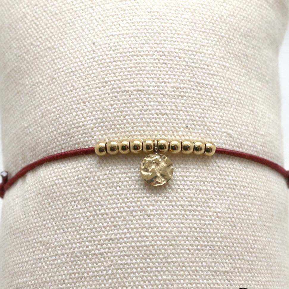 By Destele bracelet élastique bordeaux et noeud coulissant perles dorées en acier inoxydable