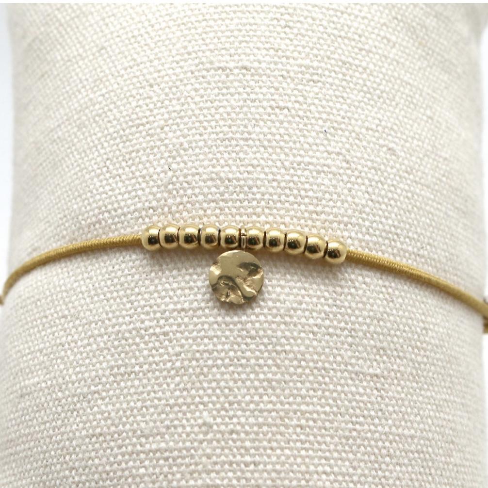 By Destele bracelet élastique safran et noeud coulissant perles dorées en acier inoxydable