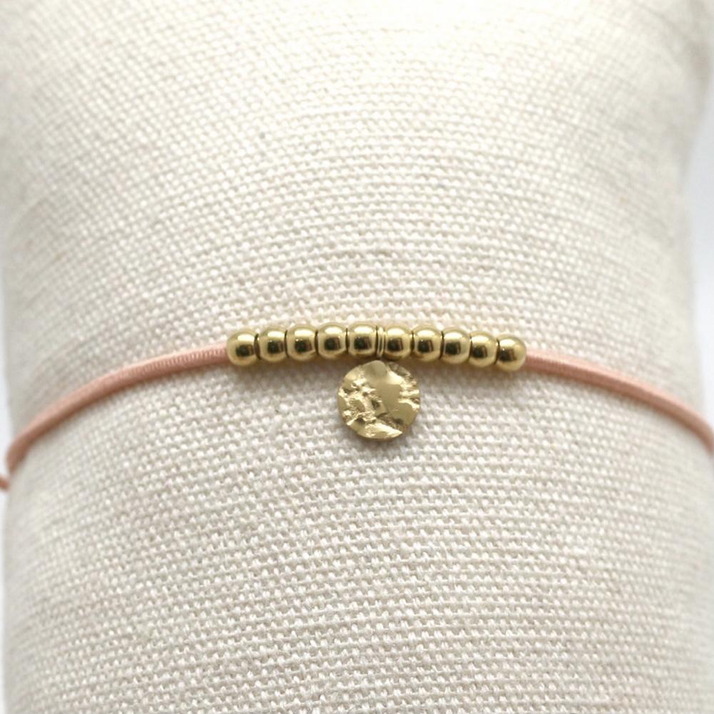 By Destele bracelet élastique nude et noeud coulissant perles dorées en acier inoxydable